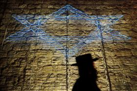 Haredi shadow and star Photo: Miriam Alistair Flash90