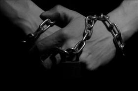 Hands in chains, source: publicdomainpictures.net